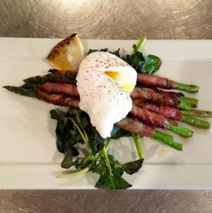 pancetta wrapped asparagus. Poached egg from @storey_farms. Truffle oil.